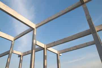 Structure of concrete for building construction on blue sky background. Minimal