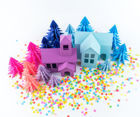 Advent calendar for baby color bright. House and Christmas tree paper hack. Party with rainbow confetti.