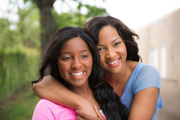 Portrait of an African American mother and her daugher.