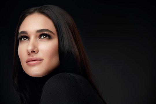 Beauty Face Makeup. Beautiful Smiling Woman With Makeup On Black