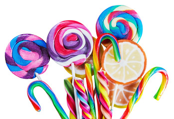 sweets are different on black background, lollipops and candies on a white background