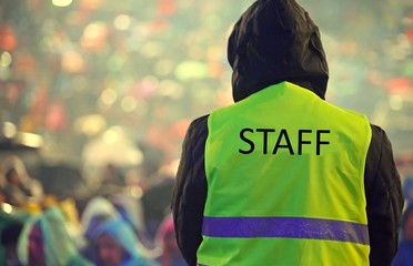 guard with the phosphorescent vest at the concert and during a s