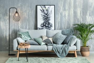 Modern interior of room with grey sofa
