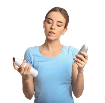 Young woman with different types of deodorant on white background