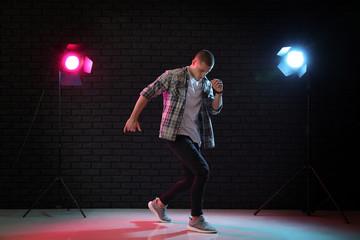 Young man dancing in club