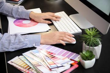 Female designer working on new logo in office