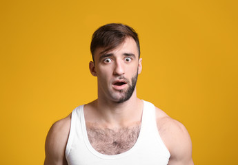 Shocked man having half of his face shaved against color background