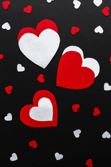 Valentines day. Paper hearts red and white on a black background. Holiday background