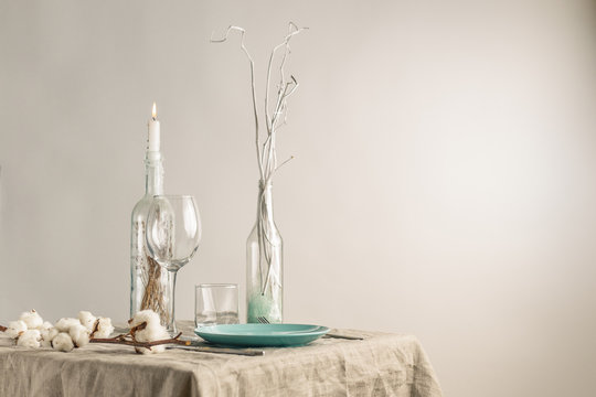Festive winter table set with glass bottles