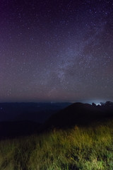 grass in the dark and star in the sky on top of the mountain at mon jong doi, Chiang mai, Thailand