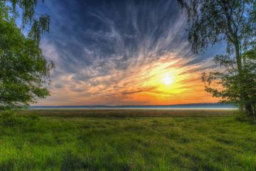 Fototapeta Wschód słońca łąka obraz