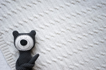 Dark blue bear toy for children stuff illustration, knitted textile bright background, top view, flat lay with space for your design