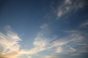 The bright background of the sky is covered with beautiful clouds. Very light clouds and sky soar across the horizon. Wind accelerates paint with a blue background image of nature.