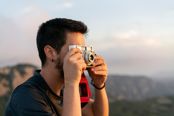 Spain, Barcelona, Natural Park of Sant Llorenc, man taking a picture of the view
