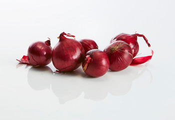 Red onions on white ground