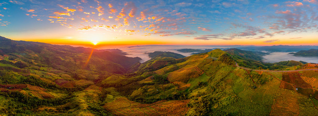 Beautiful panorama air view of mountain rang with hightway road at sunrise time.