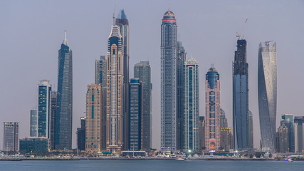 Dubai Marina skyline day to night timelapse as seen from Palm Jumeirah in Dubai, UAE.