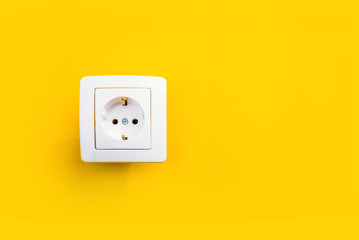 white electrical outlet on isolated yellow background