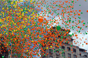 Balloons are released in the sky of downtown Sao Paulo as part of year-end celebrations