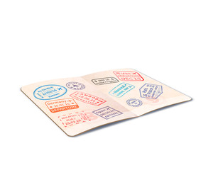 Open foreign passport full of immigration stamps, travel document in perspective on white