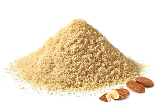 Almond flour pile or grated almonds side view isolated on white background