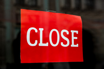 Word Close Printed In White Font On Bright Red Background. Concept Close. Red Sign With The Words Close On Glass Of Store Or Shop.