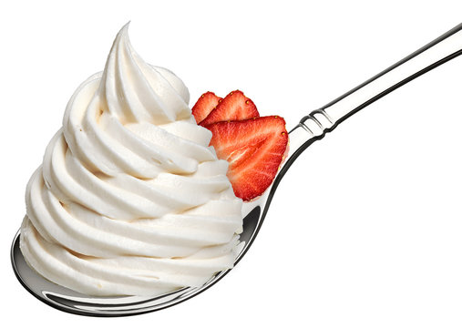 Whipped frozen yogurt or cream and strawberry in spoon isolated on white background.