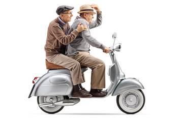 Two senior men riding a vintage scooter fast