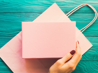 Pink gift box on shopping bag