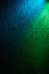 On the textural background, two colors are green and blue with dimming