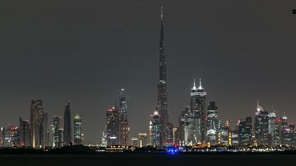 Skyline of Downtown Dubai at night timelapse.