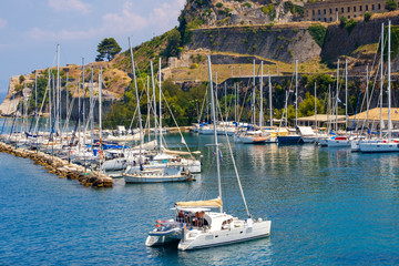 Beautiful island of Corfu and old fortress in the foreground of the wonderful blue sea  ( Kerkyra )