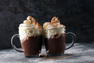 Fotobehang Chocolade Hot chocolate cocoa with whipped cream for xmas on table