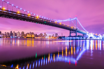 Wall Mural - View of RFK Triborough Bridge from Astoria Queens towards Roosevelt Island and Manhattan New York City seen at night