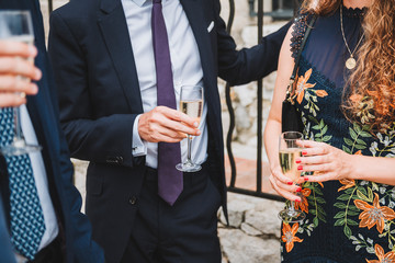 People drinking champagne or sparkling wine at a social event or party