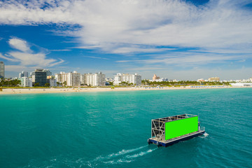 Advertising boat barge Miami Beach green screen aerial image
