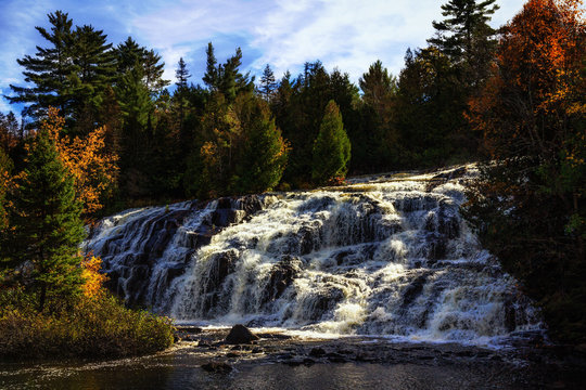 Bond Falls waterfall in Michigan's Upper Peninsula. Spectacular autumn waterfall background with copy space.