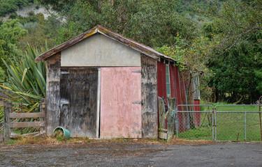 Weather-beaten building with a pink door