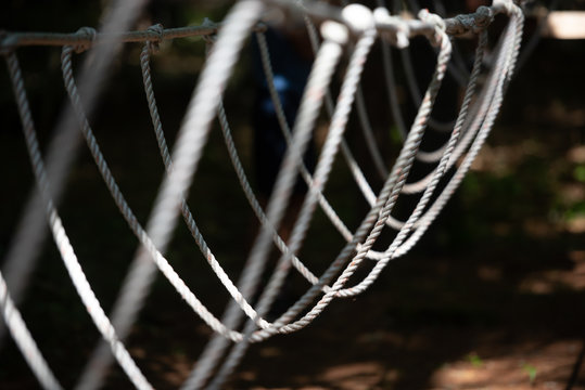 A rope bridge at a backyard low ropes course