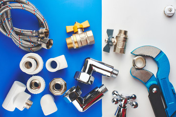 Plumbing parts, accessories and tools on a blue white background.