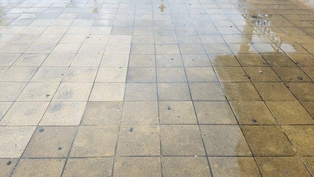wet grey square floor tiles on ground