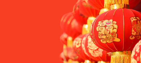 "traditional red Chinese lantern decorated for the Chinese New Year (Spring Festival), the Chinese characters ""fa"" on the lantern which means ""fortune"" or ""rich""."