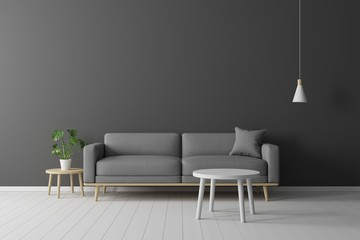 Minimal concept. interior of living grey fabric sofa, wooden table, ceiling lamp and frame on wooden floor and black wall.