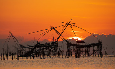Sunrise with traditional fishing trap in Pak Pra village, Phatthalung, Thailand.