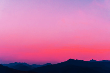 Poster Candy pink Mountain scenery view landscape with twilight sky beautiful magenta color tone theme sunset and sunrise background.
