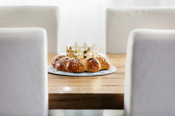King Cake or King Bread, called in German language Dreikönigskuchen, baked in Switzerland on January 6th,. Small plastic figure is hidden inside. The person, who finds it, is the king of the day