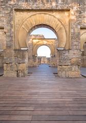 Fototapeta Detail of an arab arch in the ruins of Medina Azahara in Cordoba, Spain at sunset.