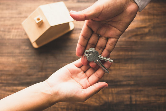 Real estate concept,top view of banker agency give house key to buyer