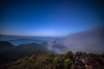 starlight at the top of a foggy mountain