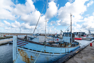 Old traditional fishing boat in a Scandinavian harbor